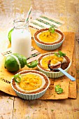 Small coconut, lime and mango cheesecakes