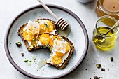 Bread topped with kumquats, honey and pistachios