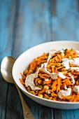 Vegetarian carrot and chickpea salad with red onion, herbs and a sumac yoghurt dressing
