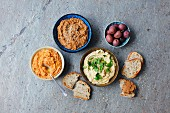 Hummus - traditional, with sunddried tomatoes, with sundried tomatoes and black olives