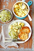 Pork schnitzel with braised cabbage and potatoes