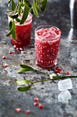 Pomegranate and coconut cocktails with ice cubes