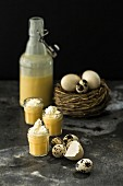 Homemade egg liqueur with whipped cream