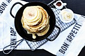 Pancakes with maple syrup and banana
