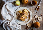 A piece of autumnal pear cake with caramel sauce