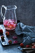 Strawberry punch in a glass jug