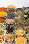 Small glass jars of mixed spices