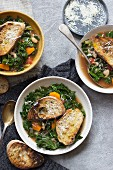 Ribollita soup with kale, carrot, tomatoes, parmesan and bread