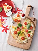 Cherry tomato, cheese and basil pizza