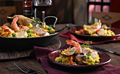Spanish paella with cod, prawns and mussels