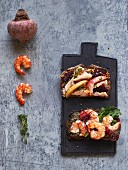 Wholemeal bread with herring salad and olive tapenade with prawns
