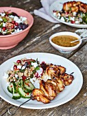 Chicken kababs with satay dip, cucumber salad and buckwheat salad