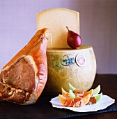 A still life with Proscuitto, melon, and cheese