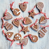 Various gingerbread biscuits decorated with white icing