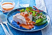 Cod with pepper sauce and salad