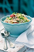 Noodle salad with cherry tomatoes, olives and cucumbers