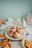 Apricot cupcakes on a plate with icing sugar