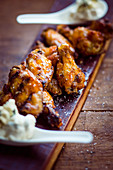 Grilled chicken wings on a wooden board