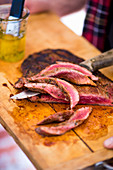 Grilled flat steak, sliced