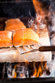 Salmon being grilled on a salt slab