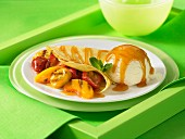 Fruit filled crepe ice cream butterscotch sauce