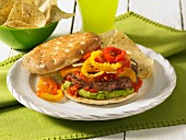 Beef burger with guacamole and hot peppers
