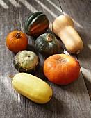 Various pumpkins on a wooden surface