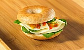 Bagel with cheese, spinach and chopped tomato