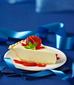 Cream cheese pie with strawberry sauce