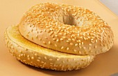 A toasted sesame bagel, sliced