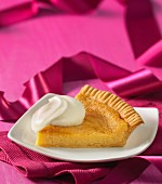 A slice of sugar pie with whipped cream