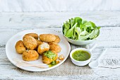 Breaded fishcakes with green sauce