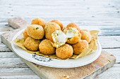 Fried potato balls with cheese centres