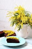 Chocolate cake with yellow flowers