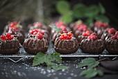 Mini chocolate gugelhupfs with various red berries (vegan)