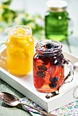 Various fruit jellies in glass jars