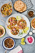 Tostadas with pulled pork, corn salsa and onions