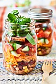 Vegetable salads in glass jars (picnic food)