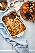 Self-saucing pudding with dried fruits and nuts
