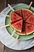 Wedges of watermelon on lollipop sticks
