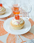 Cupcakes with buttercream and a glace cherry