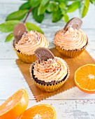 Chocolate cupcakes with orange buttercream