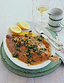 Plaice with herbs and lemon slices