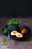 Eggs marinated in soy sauce with fresh cress