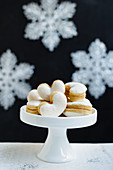 Meringue cookies filled with jam on a cake stand