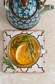 Lemon and rosemary tea in a teacup