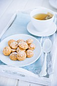 Amaretti biscuits and a teacup