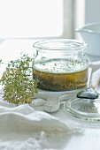 Homemade herb oil in a glass