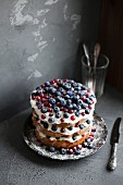 Layer cake with berries and cream