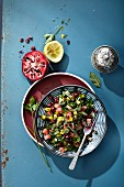 Parsley salad with pomegranate seeds and watermelon